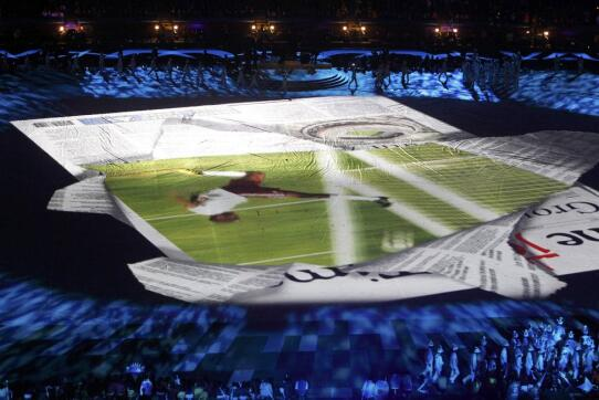 Performers walk past a projection during the closing ceremony of the 2010 World Cup at Soccer City stadium in Johannesburg -0KTE4660.jpg-